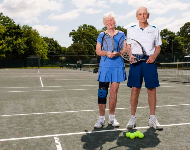 A ederly couple playing tennis